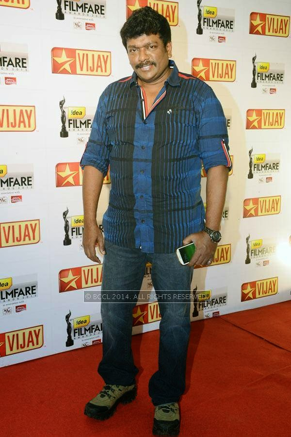 R Parthiepan arrives for the 61st Idea Filmfare Awards South, held at Jawaharlal Nehru Stadium in Chennai, on July 12, 2014.