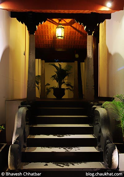 Welcome porch with steps sided by Yalis, at Savya Rasa [Koregaon Park, Pune]