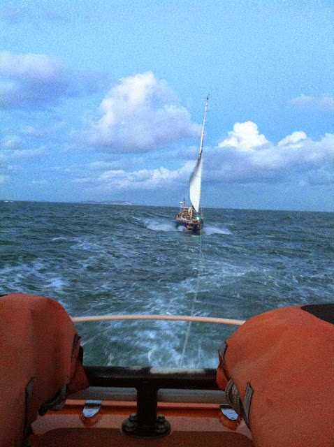 Poole all-weather lifeboat towing an 11.3m yacht with two people onboard. 10 August 2014 Photo: RNLI Poole/Dave Riley