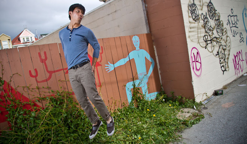 Fish Bone SOBs jumping fearfully in front of mural