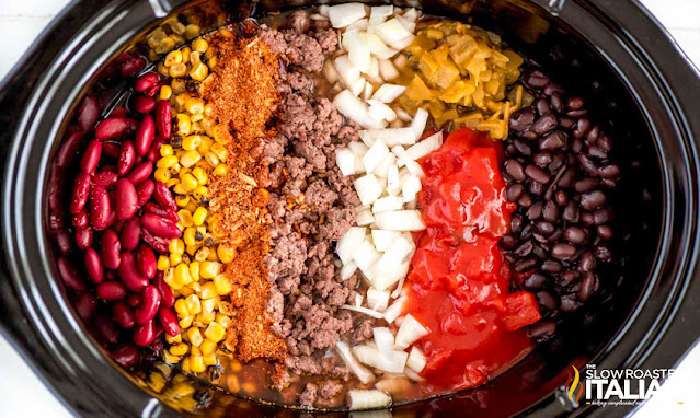 beef taco soup ingredients in a slow cooker