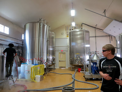 Water drains into the floor while steam makes the brewing process seem magical at Ommegang Brewery
