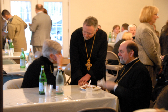 Fr. Chad and Fr. John chat with Edna.
