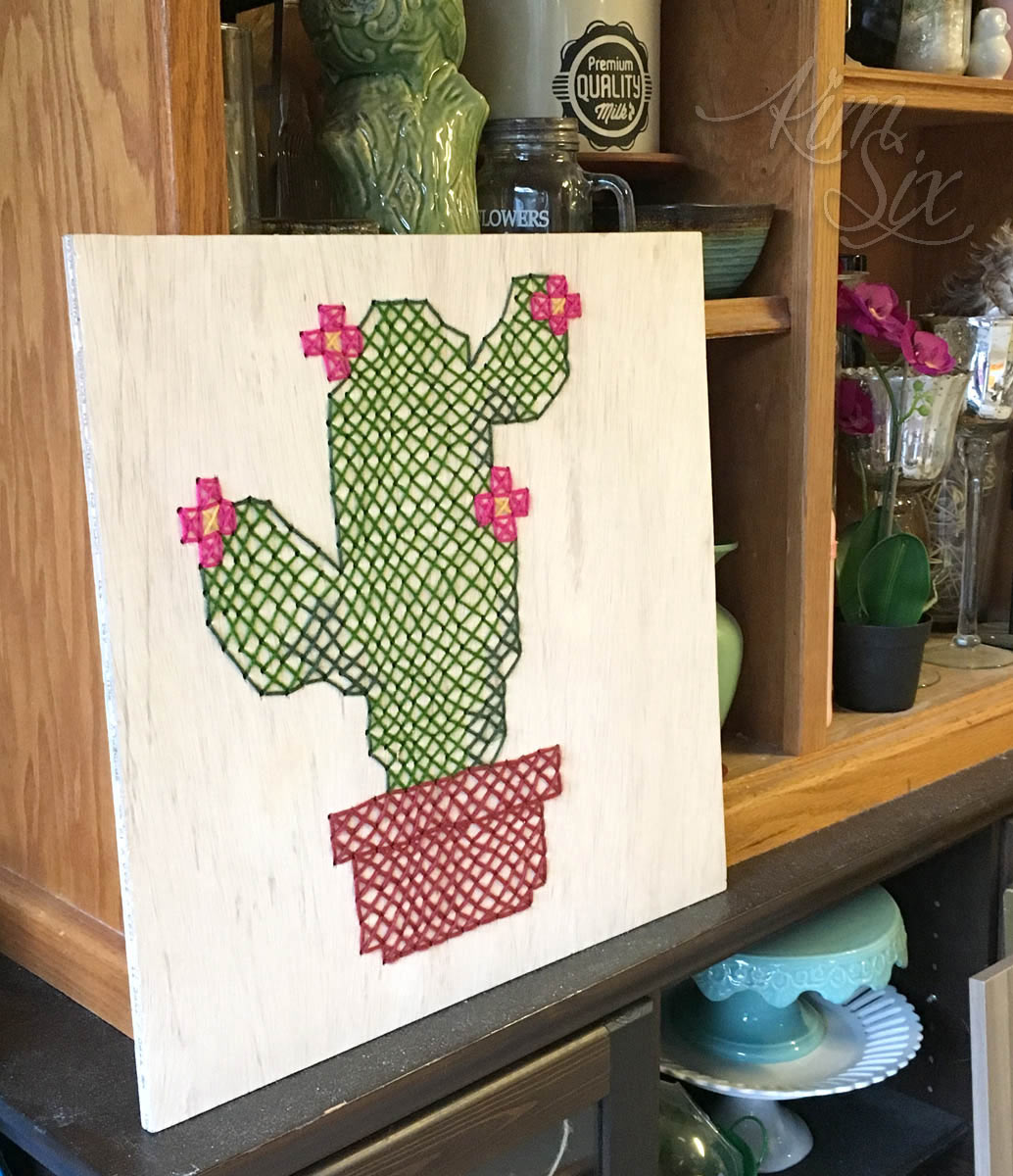 Cross stitched plywood board