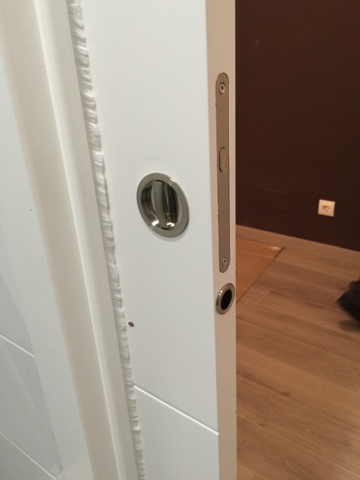 Karpinteria puertas armarios y tarimas trabajos de for Tirador embutido puerta corredera