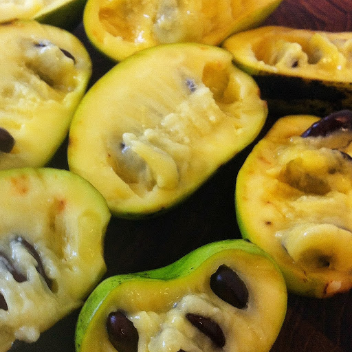 pawpaws on the cutting board. How to forage, cook, and eat pawpaws - an interview with author Sara Bir