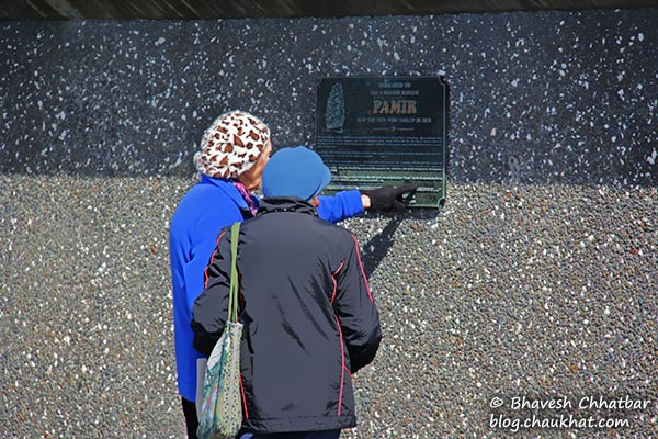 Elderly, reading a plaque at Frank Kitts Park at Wellington [New Zealand]