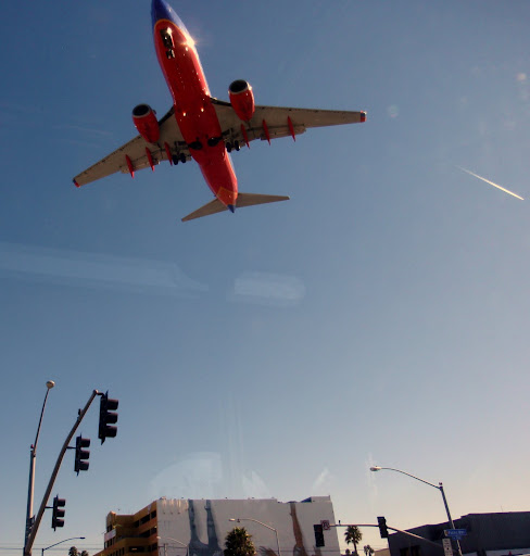 The airport, close to downtown, brings planes close overhead.