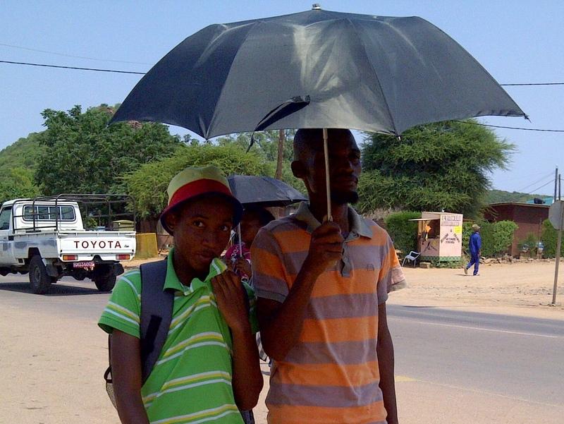 Mostly women carry umbrellas, but some guys do too