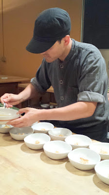 Ryan plating geoduck with toasted matsutake sautéed miso butter