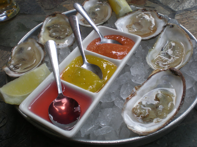 3 Raspberry Point, 3 Pickle Point oysters, and raspberry mignonette, mango habanero, and traditional cocktail sauce