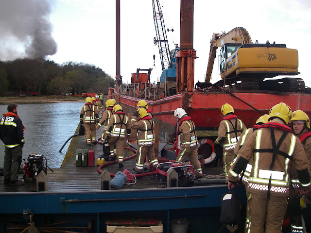 20 April 2012 - More firefighters arrive with equipment to fight the fire at a 6-bedroom property under construction on Green Island. Photo: RNLI/Poole Lifeboat Station Anne Millman