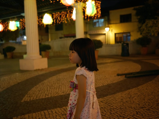 young girl standing under Mid-Autumn Festival lanterns in Taipa Village, Macau