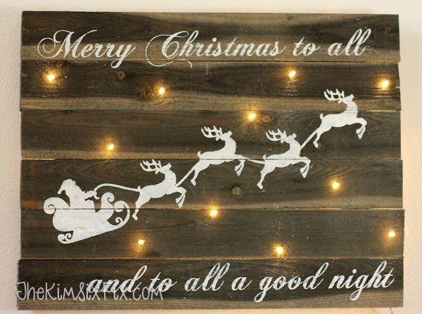 Reclaimed barn wood sign with christmas lights