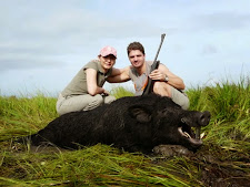 Hubert and Petra from Austria with a great wild boar during the rainy season at Carmor Plains