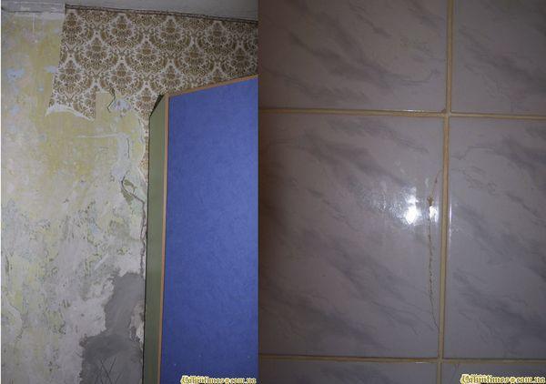 Тріщини в стінах і плитці - наслідок просідання будинку Пузин під вагою стіни.