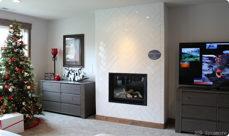 horizontal fireplace with herringbone tile