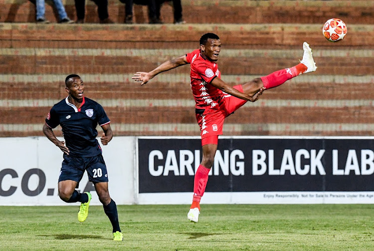 Mothobi Mvala of Highlands Park and Sifiso Mbhele of Free State Stars during the Absa Premiership match between Highlands Park and Free State Stars at Makhulong Stadium on April 17, 2019 in Johannesburg, South Africa.