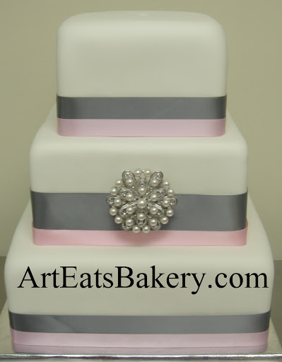 Unique creative modern square gray and pink ribbons and pearl brooch wedding cake design idea picture