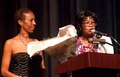 Ms. Millerbeing lauded by Karen Wilson, President of Iota Epsilon Omega Chapter of Alpha Kappa Alpha Sorority, Inc. on the stage.   Photos by TOM HART/  FREELANCE PHOTOGRAPHER