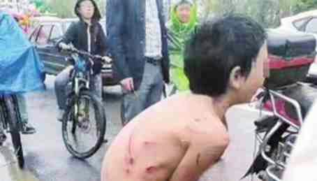 Father tied son to a motorbike and dragged naked through the streets