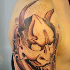 face shoulder angel and demon tattoo