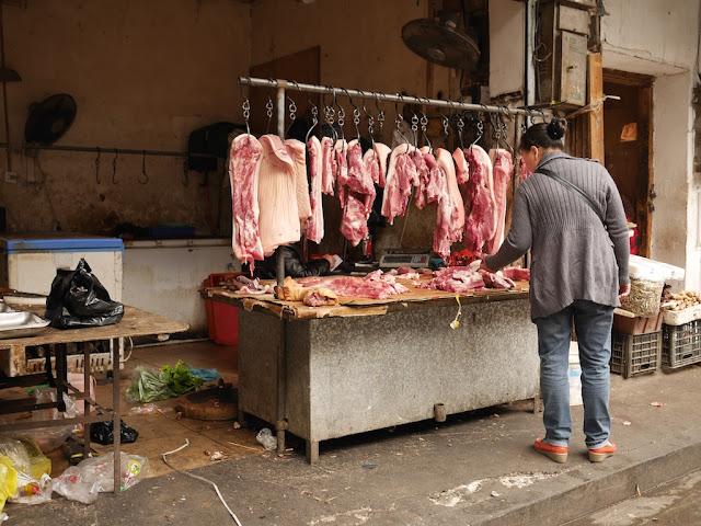 hanging raw meat for sale in Changsha