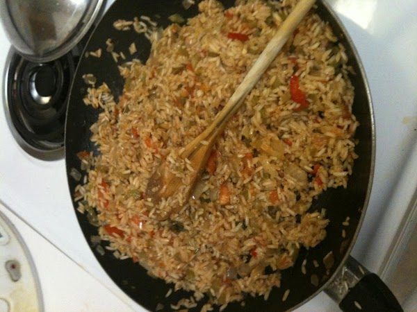 Heat oil in a large skillet over Medium-High heat. Add rice and begin to...