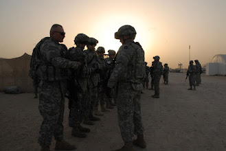 Photo: 34th Red Bull Infantry Division Soldiers prepare for training at Camp Buehring, Kuwait April 17.