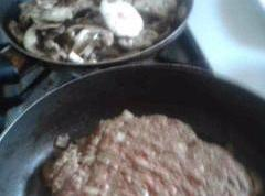 Get two pans heated to medieum high.Place burger in one, and butter and mushrooms...