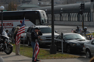 Photo: The OMLT Soldiers' bus pulls in front of the St. Paul, Minn. Armory, being escorted from Ft. McCoy, Wisc. by police and the Patriot Guard. The twelve Soldiers making up the Operational Mentoring Liaison Team (OMLT) from the Minnesota Army National Guard returned to Minnesota from a one-year deployment to Afghanistan in support of Operation Enduring Freedom on Nov. 6.