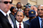 Schabir Shaik outside the Durban high court during his 2005 trial in which he was found guilty of fraud  and sentenced to 15 years. He was released controversially after serving just over two years.