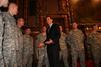 Photo: Governor Pawlenty talks with Soldiers from the Operation Mentoring Liasion Team at a deployment ceremony at the State Capital in St. Paul, MN.