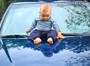 Photo: Wes discovers his reflection on our car hood.. We are all amazed by that baby!