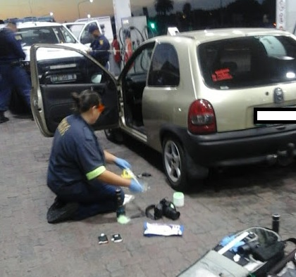 Forensic experts at the Caltex Garage in Linton Grange