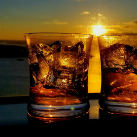 Drinks at sunset by LaDonna McCray - Food & Drink Alcohol & Drinks ( sky, landscape photography, ocean, sunshine, sunset, drinks, ice, sun, sea )