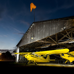 Time to Fly by Trey Amick - Transportation Airplanes ( 10-24mm, light painting, hanger, airplanes, sunset, airplane, fujifilm, prop, xt-1, fuji, long exposure, yellow, longexposure )