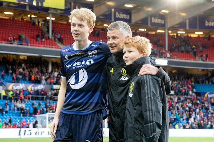 Manchester United manager Ole Gunnar Solskjaer poses with his sons Elijah Solskjaer, right, and Kristiansund's Noah Solskjaer ahead of a pre-season friendly between Kristiansund and Manchester United in Oslo, Norway on July, 30, 2019