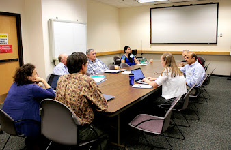 Photo: Participants from the food security symposium talk case studies that use collections in forward-thinking ways for food security research on Wednesday, Sept. 21, 2016.