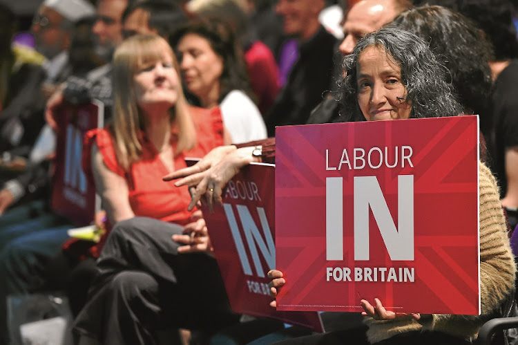 A woman poses at a Labour Party rally in support of Britain's membership of the EU. Labour leader Jeremy Corbyn says EU membership has helped to protect workers' rights and the environment. Picture: GALLO IMAGES/AFP/BEN STANSALL