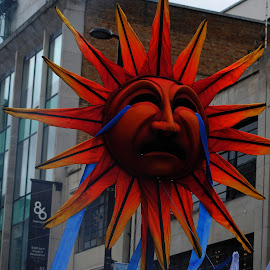 Sad  sun by Gordon Simpson - City,  Street & Park  Street Scenes