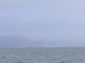 Photo: Coast Guard search and rescue helicopter drops a rescue swimmer into the Bay to pull out on a cable