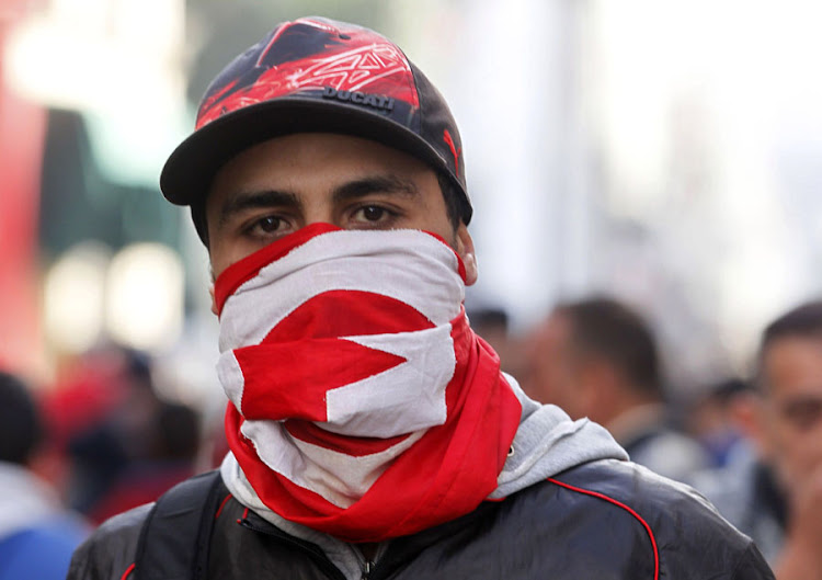 A man wears a Tunisian flag. Picture: REUTERS