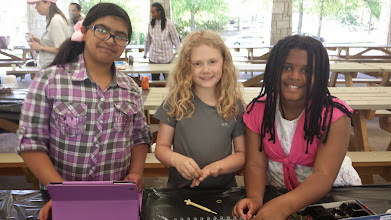 Photo: the girls making rubber band bracelets