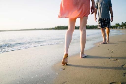 DR-Traveler-Legs-Walking-on-Beach.jpg - Stroll along a beach near Puerto Plata in the Dominican Republic.