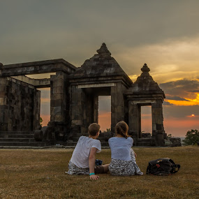 Gate of Ratu Boko Temple And Sunset by Frederiko Ferry - People Couples ( holiday, adventure, vacation, top hill, sunset, couple, man and women, gates, , landmark, travel )