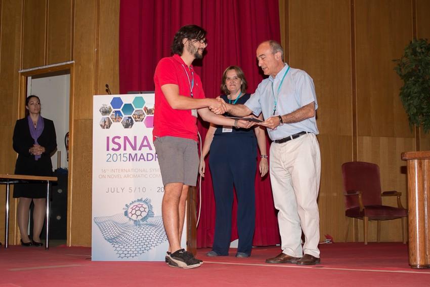 Photo: Evan receiving his poster award from Nazario Martin