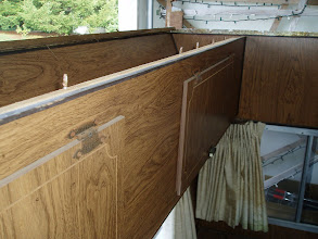 Photo: Back of bedroom upper cabinet.  You can see the screws that went up into the roof.  Not much holding the cabinet up.
