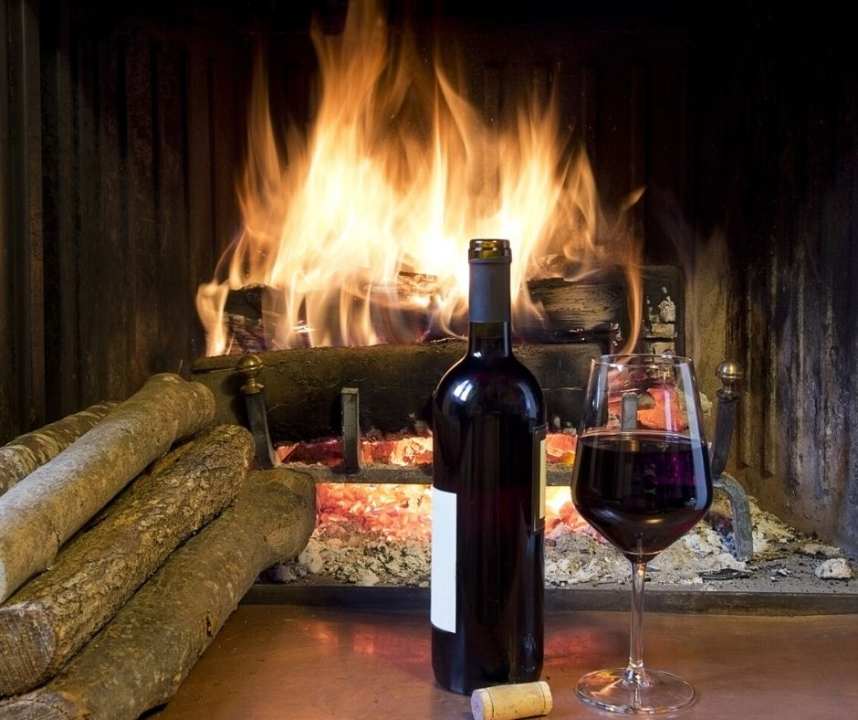 Enjoying wine in front of the fire