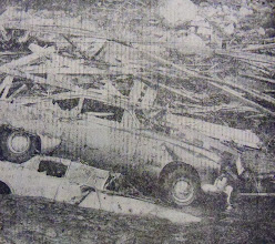 Photo: Cars are piled with debris along the banks of the Mad River.